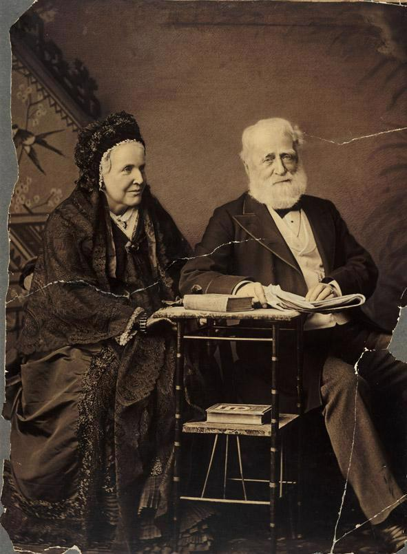 Photo portrait of James Spicer and his wife which has been damaged by rips and cracks