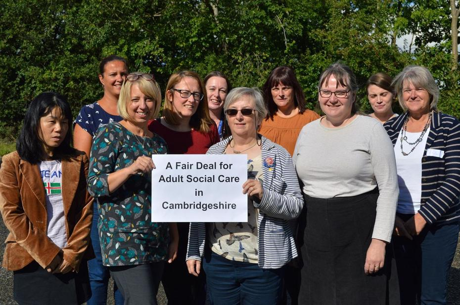Person holding a fair deal for adult social care in Cambridgeshire