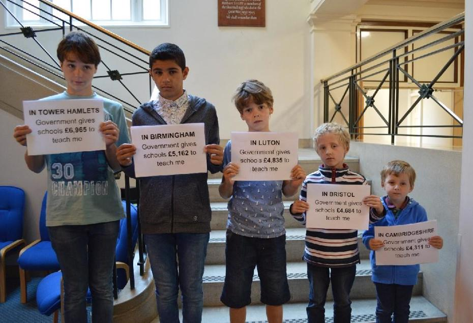 5 boys hold fair deal for Cambridgeshire placards