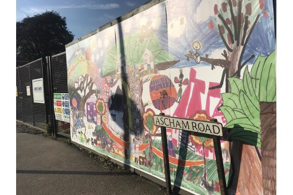 A huge temporary public artwork created by more than 400 children from Milton Road Primary School with artist Patsy Rathbone was unveiled, transforming the 50 metre stretch of builders' hoardings around the site of the new Milton Road Library.