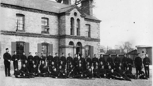 Photo of officers outside of Huntingdon barracks in 1898