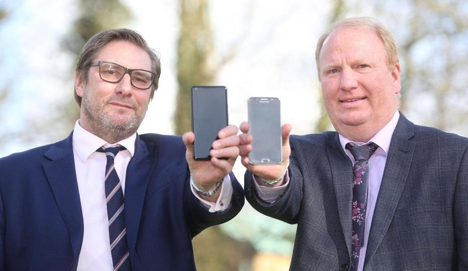 Council leader and the mayor each holding a smartphone