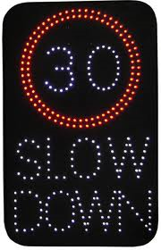 Mobile vehicle activated sign showing speed limit and slow down message