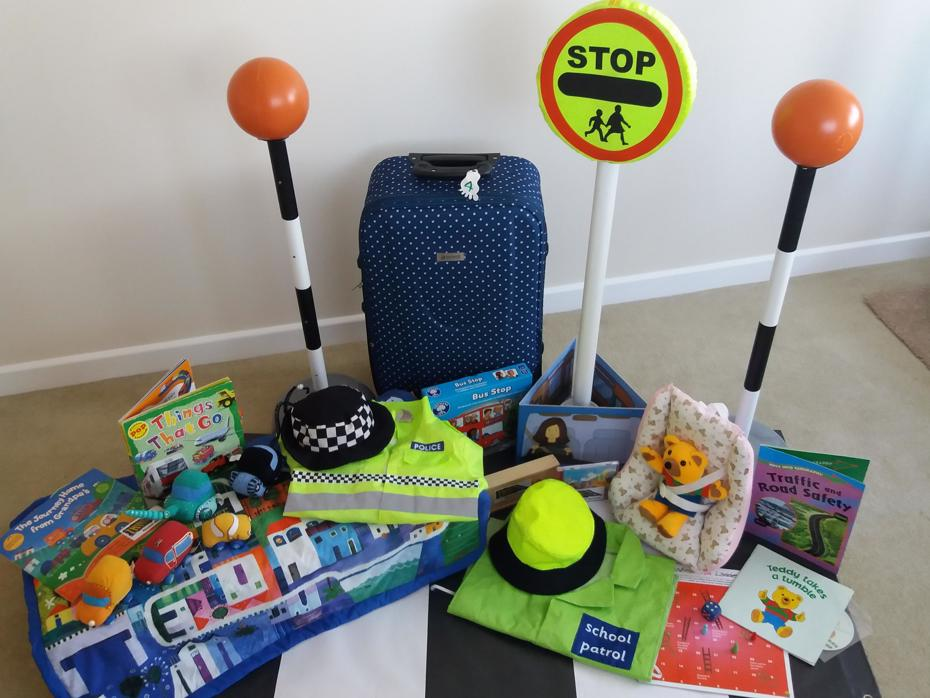 Contents of road safety toy bag including Zebra crossing play mat, hats toy stop sign, books and soft toys