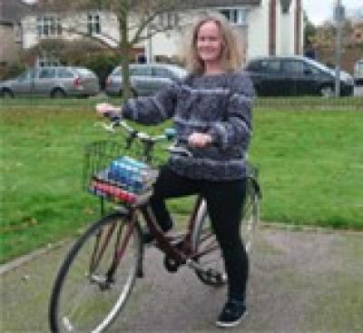 Woman on a bicycle reader to deliver books to a housebound reader