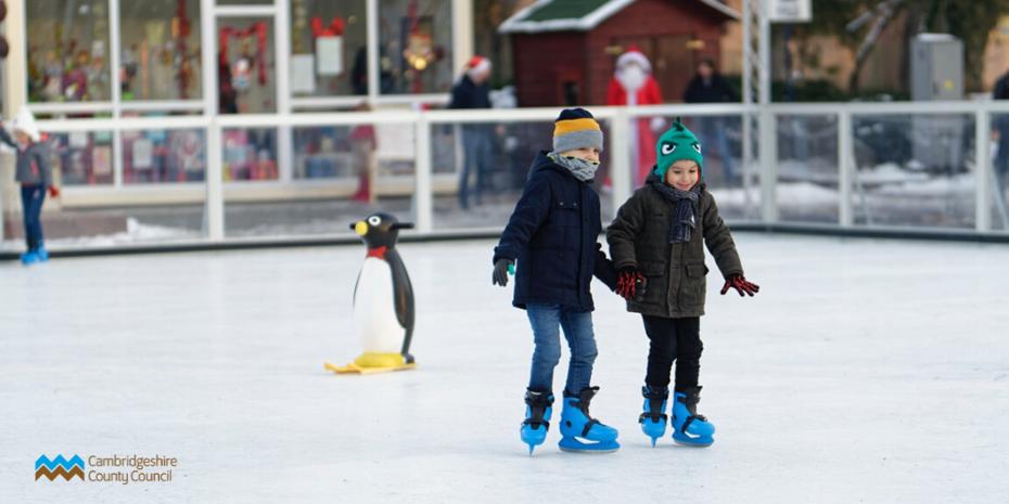 Two small children ice skating